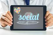 stock photo of autism  - The word social and autism awareness heart against medical interface in black and blue - JPG