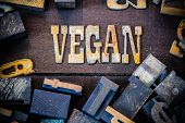 pic of vegan  - The word VEGAN written in rusted metal letters surrounded by vintage wooden and metal letterpress type - JPG
