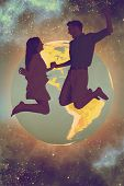 picture of starry night  - Cheerful young couple jumping against starry night sky - JPG