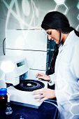 picture of centrifuge  - Science and medical graphic against focused scientist using a centrifuge - JPG