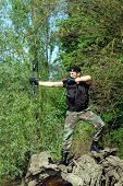 pic of bow arrow  - The soldier shoots with bow and arrow in the forest - JPG