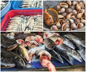 stock photo of stall  - Traditional asian fish market stall full of fresh seafood - JPG