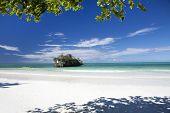 stock photo of tide  - The rock is an Islet situated along the Michamvi beach Zanzibar Tanzania - JPG