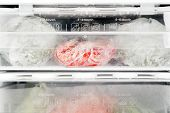 image of frozen food  - Freezer interior with assorted frozen food Close up - JPG