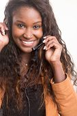 picture of telephone operator  - A friendly african telephone operator smiling isolated over a white background - JPG