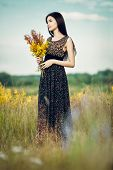 Постер, плакат: Brunette With Flowers