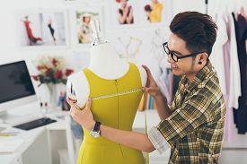 picture of dress mannequin  - Professional dressmaker measuring a dress on the mannequin - JPG
