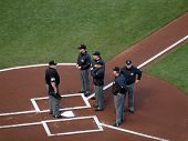 Head Umpire Talk To Five Other Umpires At Homeplate Before Start Of Game