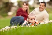 Happy Baby Boy And Mixed Race Parents Playing In The Park
