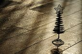Silhouette Of The Christmas Tree On A Wooden Floor