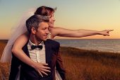 wedding couple outstretched finger showing destination poster