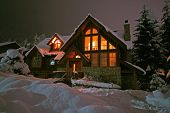 stock photo of blanket snow  - a winter home in whistler bc blanketed by a fresh dumping of snow - JPG