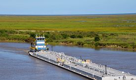 pic of barge  - Oil barge being pushed thru the waterway by a tugboat  - JPG