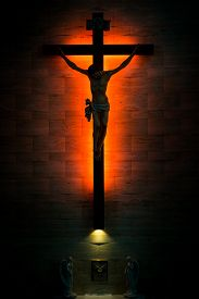 stock photo of tabernacle  - Catholic Christian Crucifix in silhouette with tabernacle underneath - JPG