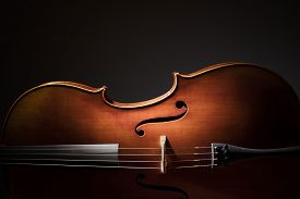 foto of cello  - Silhouette of a Cello on black background with copy space for music concept - JPG