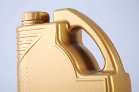 stock photo of lube  - golden canister with engine oil on white background - JPG