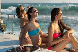 picture of yacht  - Girls sunbathing on a yacht - JPG