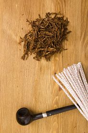 stock photo of tobacco-pipe  - Tobacco smoking and cleaning tools pipe in its narrowest part - JPG