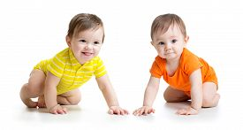 stock photo of crawl  - Two cute babies boys crawling on floor - JPG