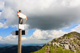 picture of italian alps  - Signboard along a mountain trekking path Italian panorama Alps - JPG