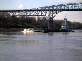 stock photo of coal barge  - tugboat pushing a coal barge down the c  - JPG
