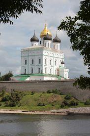 stock photo of trinity  - Trinity Cathedral on the bank of river Velikaya - JPG
