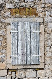 image of louvers  - Wooden window with louvers in old house in the Perast Montenegro - JPG