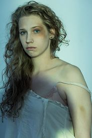 picture of bruises  - Image of scared young rape victim with bruise on face - JPG