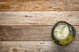 picture of buttercup  - buttercup winter squash on a grunge weathered barn wood with a copy space - JPG