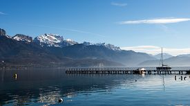 foto of annecy  - Lake Annecy in autumn under a blue sky - JPG