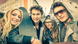 stock photo of  friends forever  - Young hipster best friends taking a selfie in urban city context  - JPG