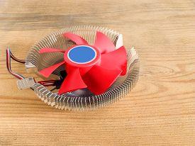 foto of cpu  - Aluminum CPU cooler heat sink on wooden background - JPG