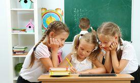 pic of schoolgirl  - Portrait of happy schoolgirls at lesson - JPG