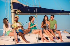 stock photo of yacht  - Cheerful young people relaxing on a yacht - JPG