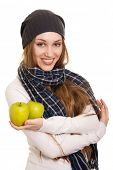Happy woman with green apple on white background