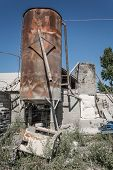 Old Rusty Industrial Cement Storage Tank. Part Of A Small Cement Factory. poster