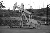 stock photo of nod  - Black and white mage of a pumpjack type oil pump - JPG