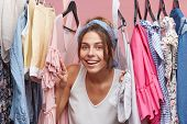 Beautiful Female With Happy Expression Looking Through Her Clothes, Being Glad To Choose Outfit By H poster