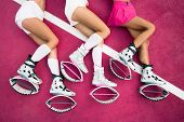 Three Sexy Legs Of Girls Laying On The Pink Background And Sexy Exercises Of Legs In Kangoo Jumps Sh poster