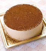 Delicious tiramisu cake with creamy vanilla custard pudding and topped with chocolate.