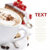 Close-up of white cup of coffee and chocolate cake (easy removable text)