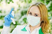 stock photo of nasal catarrh  - Doctor with inhaler spray during spring allergic blossom dust season - JPG