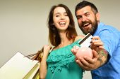 Guy With Beard And Lady With Smiling Faces Do Shopping poster