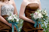 stock photo of matron  - Bridesmaids standing at the wedding ceremony holding bouquets - JPG