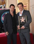 HOLLYWOOD - JAN 13:  Colin Firth & Guy Pearce (L) as actor Colin Firth receives his star on walk of fame on January 13, 2011 in Hollywood, CA
