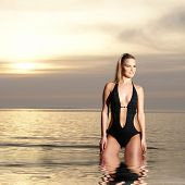 picture of monokini  - Sexy lady wearing swimsuit on the beach - JPG