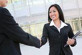 Asian Woman Handshake
