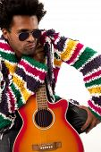 stock photo of rastaman  - A black man young and handsome with an orange and acustic guitar in one hand - JPG