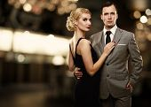stock photo of mafia  - Retro couple over blurred background - JPG