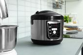 Modern Multi Cooker On Table In Kitchen poster